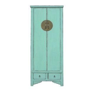 a light colored armoire