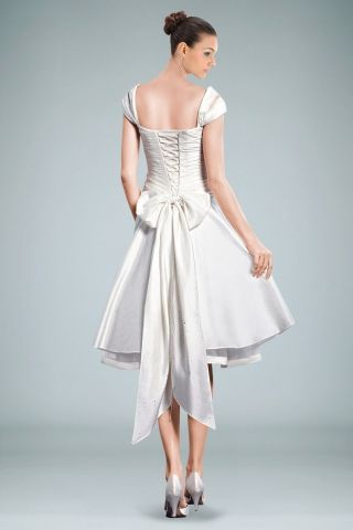 Cute, corset like back on short dress. Not crazy about the size of ...