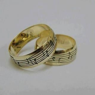 Music Notes On A Set Of Wedding Rings Synchronistic Companionship