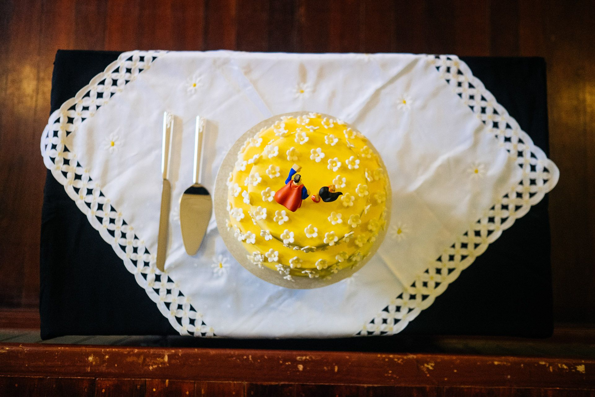 Yellow daisy wedding cake with superhero cake toppers. Bright Royal ...