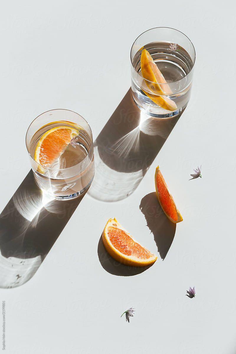Still life of orange slices in glasses with light