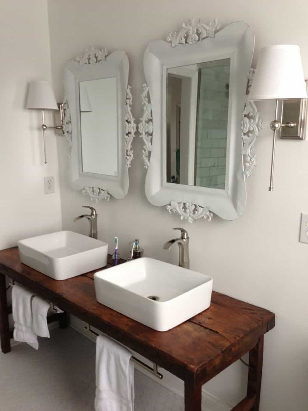 Square Vessel Sinks Installed In The Bathroom With Ornate