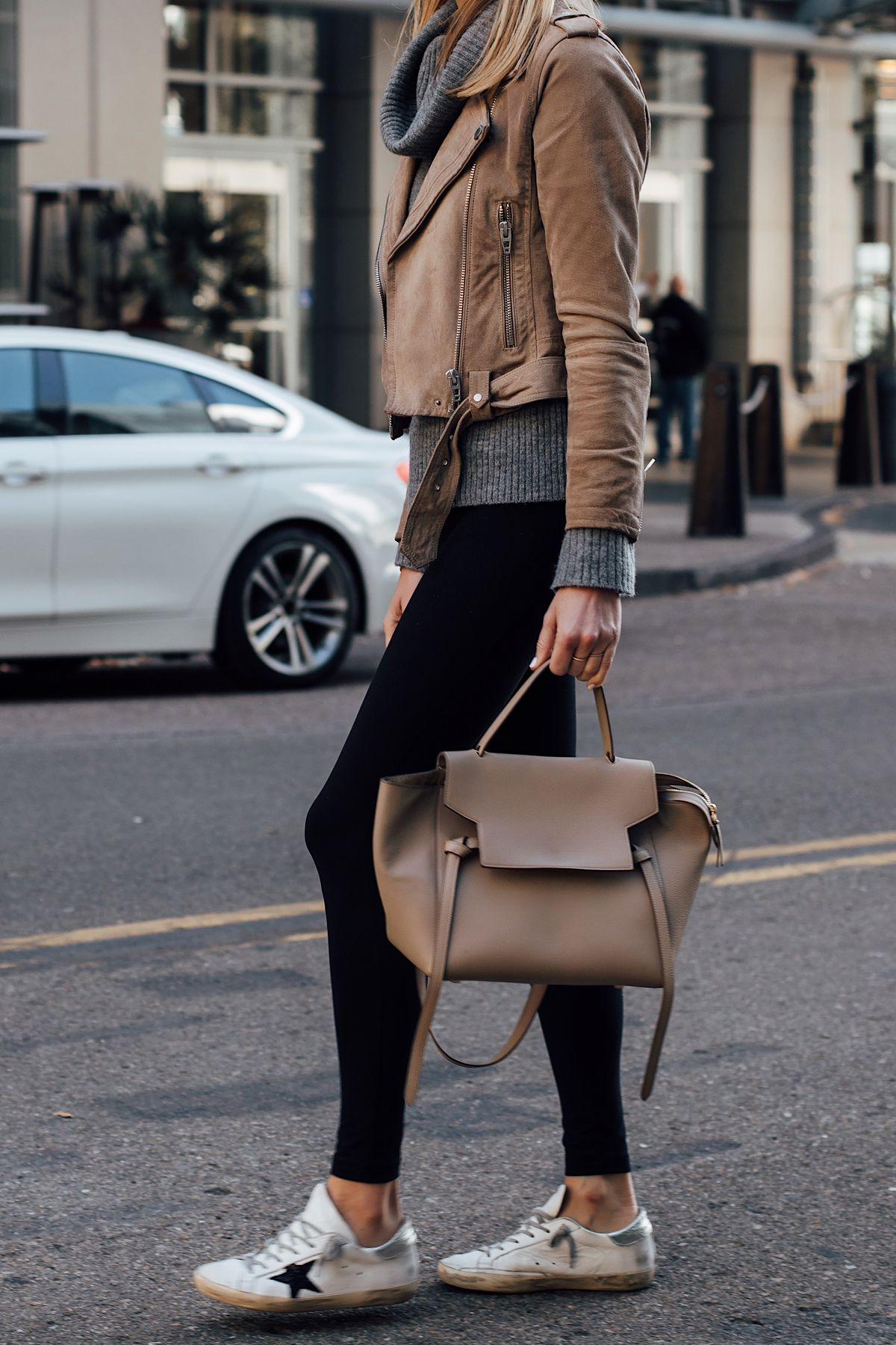 a332a094ef Blonde Woman Wearing Blanknyc Tan Suede Moto Jacket Grey Turtleneck Sweater  Black Leggings Golden Goose Sneakers Celine Mini Belt Bag Fashion Jackson  San ...