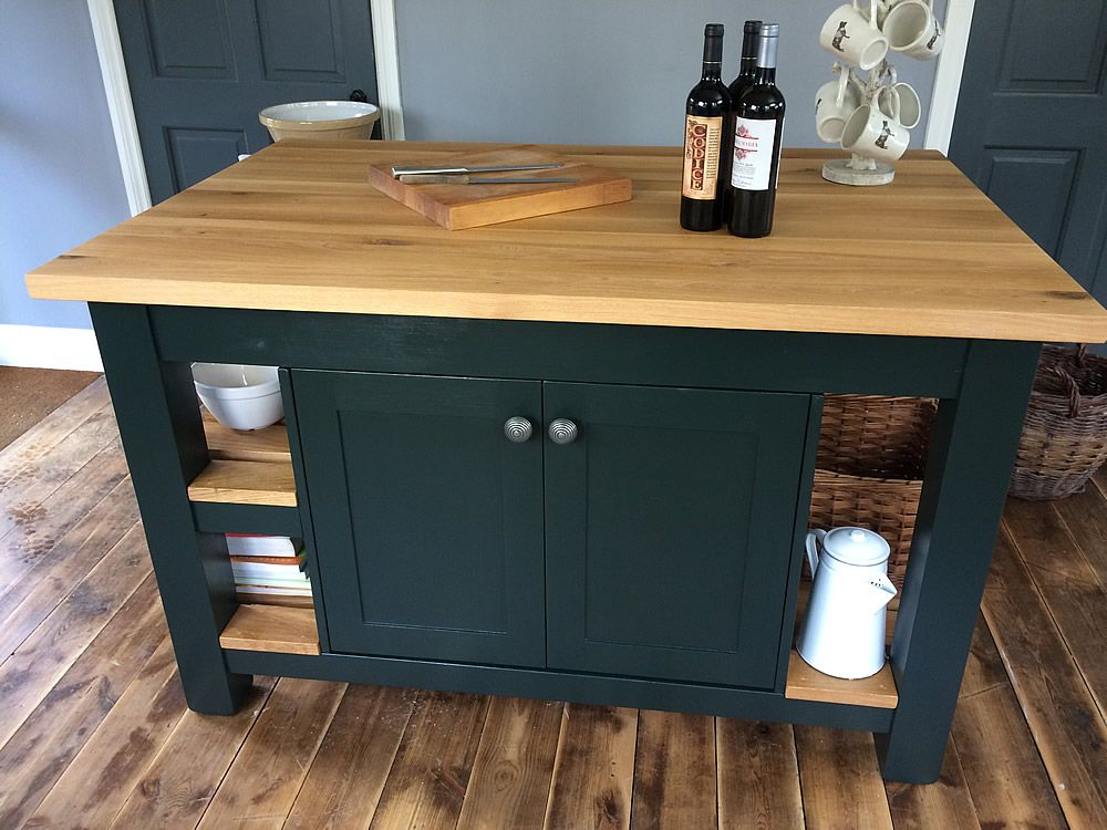 A Large Freestanding Kitchen Island Incorporating Double ...