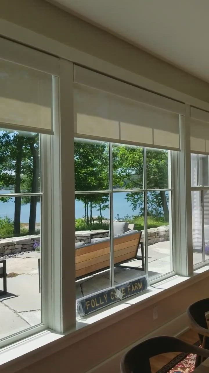 Motorized Lutron Roller Shades Installed In A Dining Room In